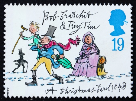 GREAT BRITAIN - CIRCA 1993: a stamp printed in the Great Britain shows Tiny Tim and Bob Cratchit, Christmas carol by Charles Dickens, circa 1993 Archivio Fotografico