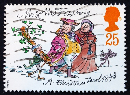 dickens: GREAT BRITAIN - CIRCA 1993: a stamp printed in the Great Britain shows Mr. and Mrs. Fezziwig, Christmas carol by Charles Dickens, circa 1993