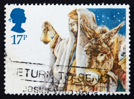 gilbert: GREAT BRITAIN - CIRCA 1984: a stamp printed in the Great Britain shows Arrival of the Holy Family in Bethlehem, crayon sketch by Yvonne Gilbert for Christmas, circa 1984
