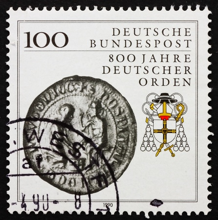 ERMANY - CIRCA 1990: a stamp printed in the Germany shows Teutonic order heraldic emblem and Seal of Col. Spittler, 800th anniversary, circa 1990 photo