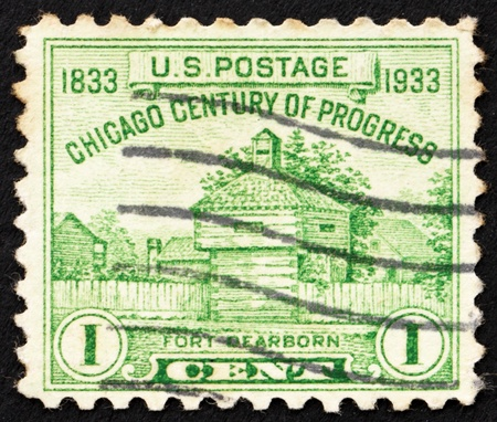 UNITED STATES OF AMERICA - CIRCA 1933: a stamp printed in the United States of America shows Fort Dearborn, restoration of original building from 1803 which was build beside the Chicago River in what is now Chicago, circa 1933 photo