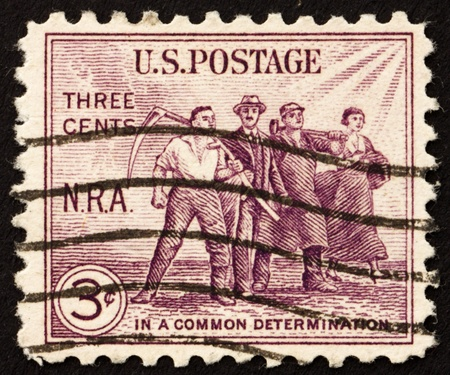 arouse: UNITED STATES OF AMERICA - CIRCA 1933: a stamp printed in the United States of America shows Group of workers, issued to arouse support for the NRA (National Recovery Administration), circa 1933 Stock Photo