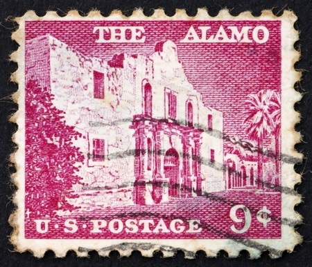 pivotal: UNITED STATES OF AMERICA - CIRCA 1954: a stamp printed in the United States of America shows The Alamo mission, the place of pivotal event in the Texas Revolution 1836, circa 1954 Stock Photo