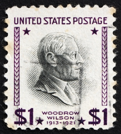 UNITED STATES OF AMERICA - CIRCA 1938: a stamp printed in the United States of America shows Woodrow Wilson, 28th President of USA 1913-1921, circa 1938 photo