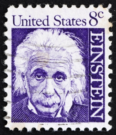 albert: UNITED STATES OF AMERICA - CIRCA 1965: a stamp printed in the United States of America shows Albert Einstein, theoretical physicist who developed the theory of general relativity, circa 1965