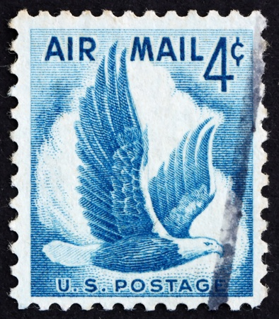 UNITED STATES OF AMERICA - CIRCA 1954: a stamp printed in the United States of America shows Eagle in flight, circa 1954 photo