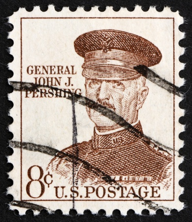 pershing: UNITED STATES OF AMERICA - CIRCA 1960: a stamp printed in the United States of America shows John J. Pershing, general officer in the U.S. Army who led the American Expeditionary Forces in World War I, circa 1960