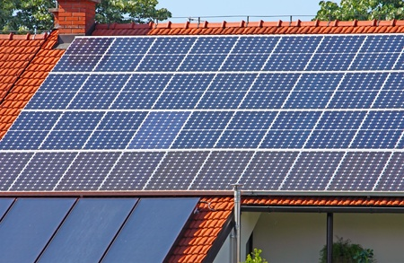 Solar panels on the roof of the house 스톡 콘텐츠