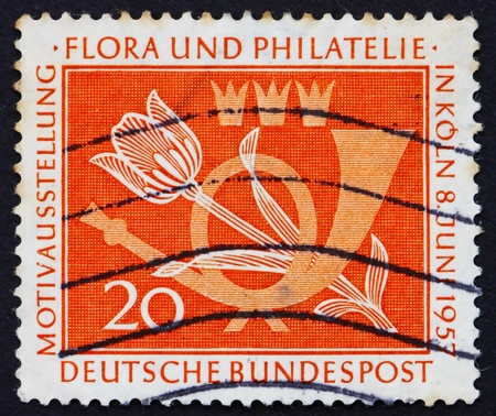 philately: GERMANY - CIRCA 1957: a stamp printed in the Germany shows Tulip and Post Horn, Flora and Philately Exhibition, Cologne, circa 1957