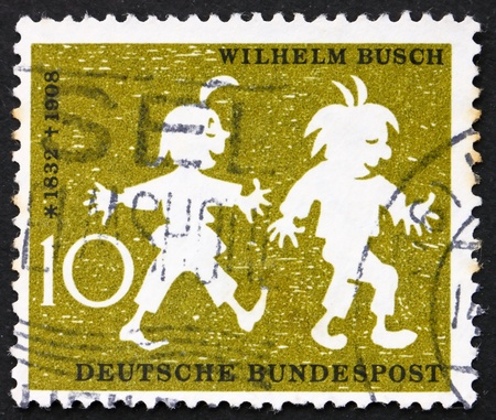 max: GERMANY - CIRCA 1958: a stamp printed in the Germany shows Max and Moritz, 50th anniversary of the death of Wilhelm Busch, humorist, circa 1958 Stock Photo