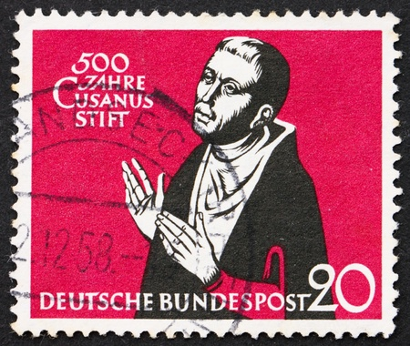 GERMANY - CIRCA 1958: a stamp printed in the Germany shows Nicolaus Cusanus, Nikolaus Krebs, 500th anniversary of Cusanus Hospice at Kues, founded by Cardinal Nicolaus, circa 1958 Stock Photo - 11732240