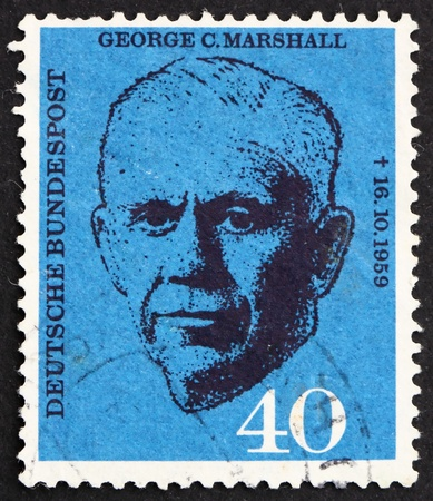 perforated stamp: GERMANY - CIRCA 1960: a stamp printed in the Germany shows George C. Marshall, US general and statesman, circa 1960
