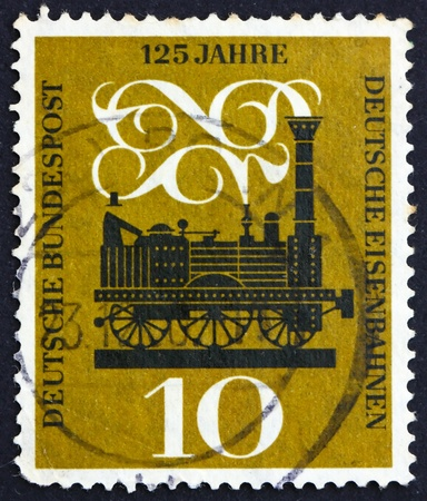 GERMANY - CIRCA 1960: a stamp printed in the Germany shows Steam Locomotive, 125th anniversary of German railroads, circa 1960 photo