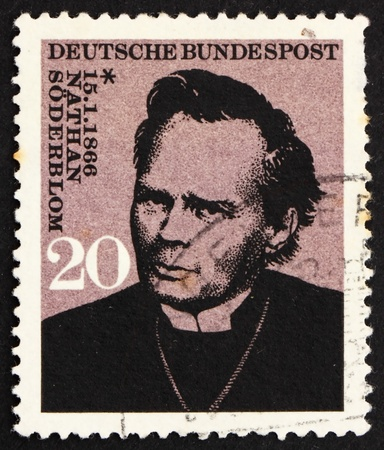 theologian: GERMANY - CIRCA 1966: a stamp printed in the Germany shows Nathan Soderblom, Swedish Protestant theologian, recipient of the 1930 Nobel Peace Prize, circa 1966