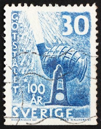 converter: SWEDEN - CIRCA 1958: a stamp printed in the Sweden shows Bessemer Converter, used in industrial process for the mass production of steel from molten pig iron, circa 1958