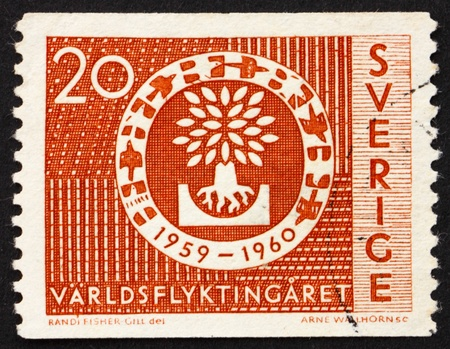 SWEDEN - CIRCA 1960: a stamp printed in the Sweden shows Uprooted Oak Emblem, World Refugee Year, circa 1960 photo