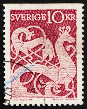 SWEDEN - CIRCA 1961: a stamp printed in the Sweden shows Rune Stone, Oland, from 11th Century, circa 1961 photo