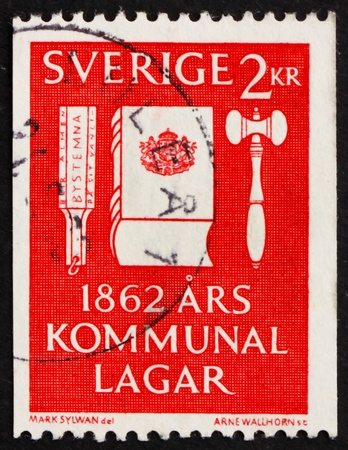 codex: SWEDEN - CIRCA 1962: a stamp printed in the Sweden shows Voting Tool, Codex of Law and Gavel, Centenary of the Municipal Reform Laws, circa 1962 Stock Photo