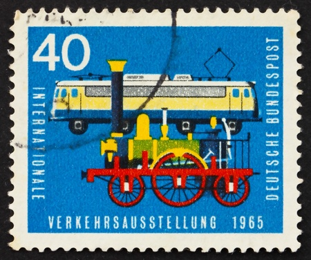 GERMANY - CIRCA 1965: a stamp printed in the Germany shows Old and new railroad engines, circa 1965 photo