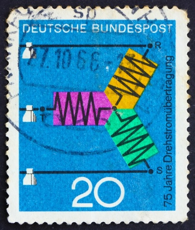 GERMANY - CIRCA 1966: a stamp printed in the Germany shows Diagram of Three-Phase Transmission, Progress in Science and Technology, circa 1966 photo
