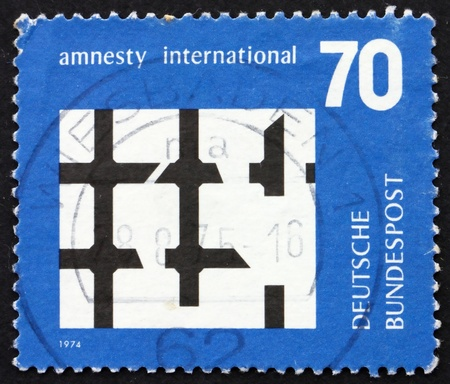 political prisoner: GERMANY - CIRCA 1974: a stamp printed in the Germany shows Broken Bars of Prison Window, Amnesty International, circa 1974 Stock Photo