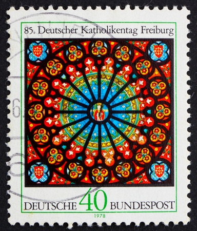 GERMANY - CIRCA 1978: a stamp printed in the Germany shows Rose Window, Freiburg Cathedral, 85th Congress of German Catholics, circa 1978 Stock Photo - 11926013