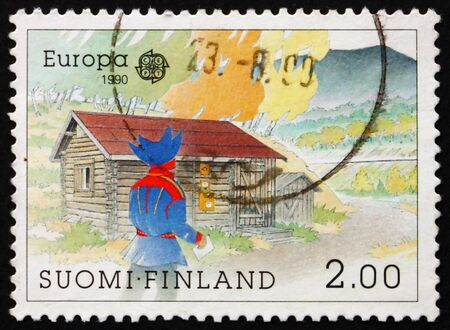 FINLAND - CIRCA 1990: a stamp printed in the Finland shows Lapp Man, P.O. at Nuvvus, Mt. Nuvvus Ailigas, circa 1990 photo