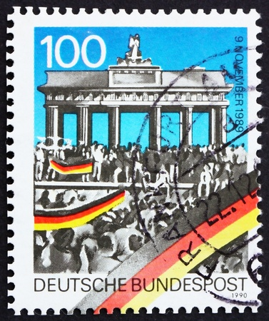 GERMANY - CIRCA 1990: a stamp printed in the Germany shows Brandenburg Gate, 1st anniversary of Opening of Berlin Wall, circa 1990 photo