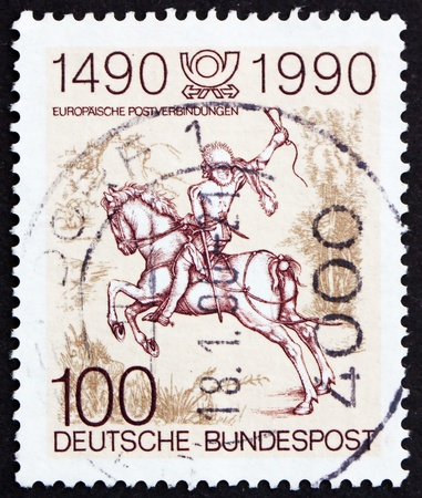 printmaker: GERMANY - CIRCA 1990: a stamp printed in the Germany shows The Young Post Rider, an Engraving by Albrecht Durer, circa 1990