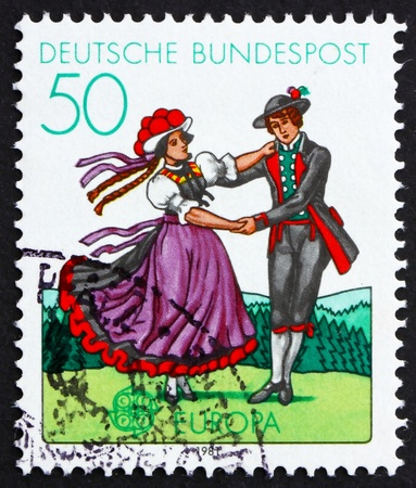 GERMANY - CIRCA 1981: a stamp printed in the Germany shows South German couple dancing in regional costumes, circa 1981 Stock Photo - 11979432