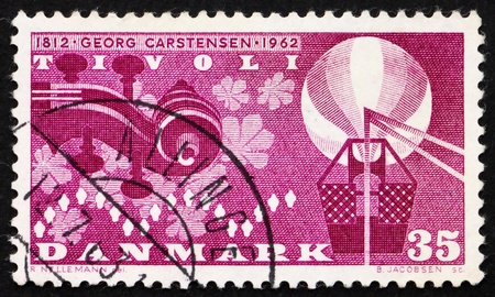 DENMARK - CIRCA 1962: a stamp printed in the Denmark shows Violin Scroll, Leaves, Lights and Baloon, 150th anniversary of the birth of Georg Carstensen, circa 1962 photo