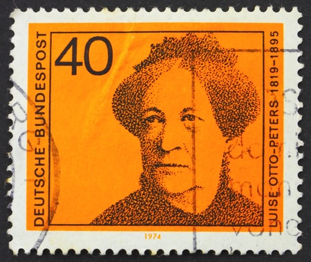 pseudonym: GERMANY - CIRCA 1974: a stamp printed in the Germany shows Luise Otto-Peters, writer and journalist, circa 1974