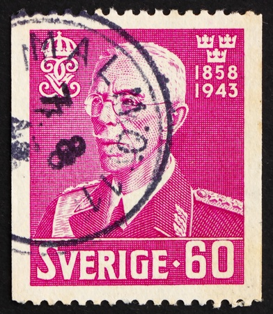 SWEDEN - CIRCA 1943: a stamp printed in the Sweden shows King Gustaf V, circa 1943 Stock Photo - 12059555