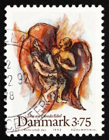 jacob: DENMARK - CIRCA 1992: a stamp printed in the Denmark shows Jacob's fight with angel, from new Danish Bible, circa 1992