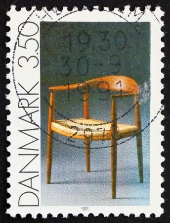 DENMARK - CIRCA 1991: a stamp printed in the Denmark shows Chair by Hans Wegner, Modern Design, circa 1991 Stock Photo