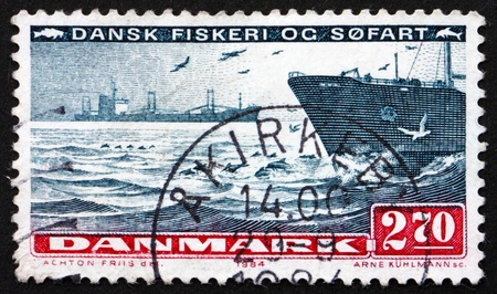 DENMARK - CIRCA 1984: a stamp printed in the Denmark shows Ships on Sea, Sea Transport, Fishing and Shipping, circa 1984 photo