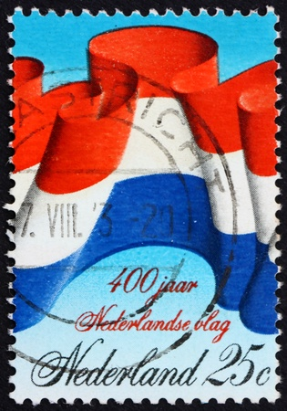 NETHERLANDS - CIRCA 1972: a stamp printed in the Netherlands shows Dutch Flag, 400th Anniversary of the Dutch Flag, circa 1972 Stock Photo - 12179567