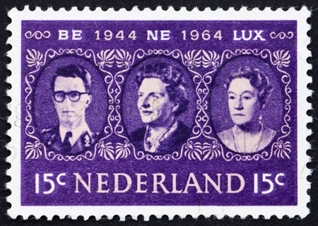 NETHERLANDS - CIRCA 1964: a stamp printed in the Netherlands shows King Baudouin, Queen Juliana and Grand Duchess Charlotte, Benelux, circa 1964 Stock Photo - 12059561