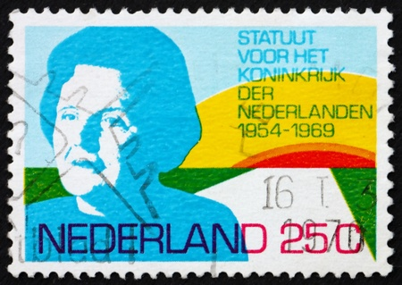 NETHERLANDS - CIRCA 1969: a stamp printed in the Netherlands shows Queen Juliana and Rising Sun, 15th anniversary of the Charter of the Kingdom of the Netherlands, circa 1969 Stock Photo - 12059559