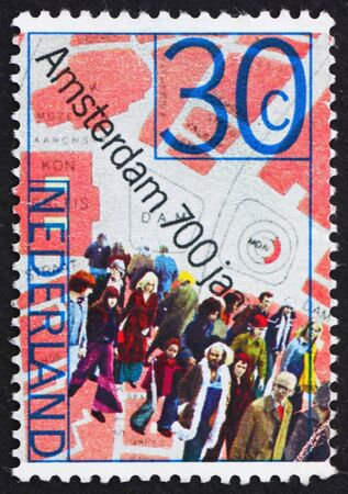 NETHERLANDS - CIRCA 1975: a stamp printed in the Netherlands shows People and Map of Dam Square, 700th anniversary of Amsterdam, circa 1975