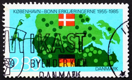 DENMARK - CIRCA 1985: a stamp printed in the Denmark shows Map and Flags of Denmark and Germany, 30th Anniversary of Bonn-Copenhagen Declaration, circa 1985 photo