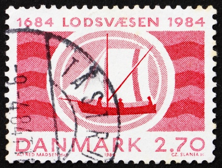 pilotage: DENMARK - CIRCA 1987: a stamp printed in the Denmark shows Boat, 300th Anniversary of Pilotage Service, circa 1987 Stock Photo