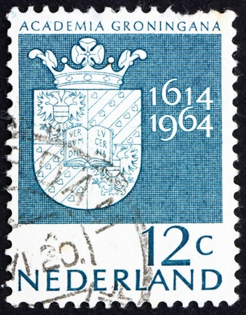 NETHERLANDS - CIRCA 1964: a stamp printed in the Netherlands shows Arms of Groningen University, 350th anniversary of the University of Groningen, circa 1964 Stock Photo - 12179584