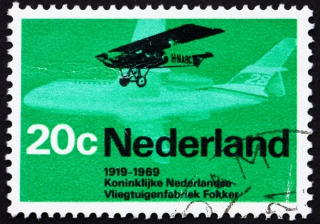 NETHERLANDS - CIRCA 1968: a stamp printed in the Netherlands shows Fokker F.2 from 1919 and Friendship F.29, circa 1968 photo