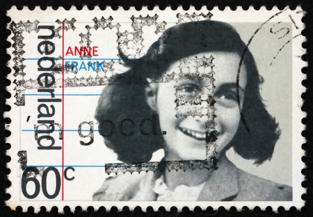 NETHERLANDS - CIRCA 1980: a stamp printed in the Netherlands shows Anne Frank, Victim of the Holocaust, 35th anniversary of liberation of the Germans, circa 1980