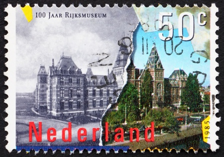 NETHERLANDS - CIRCA 1985: a stamp printed in the Netherlands shows National Museum of Fine Arts, Amsterdam, centenary, circa 1985 Stock Photo - 12180349