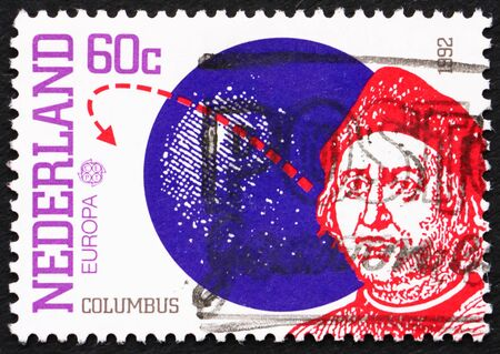 NETHERLANDS - CIRCA 1992: a stamp printed in the Netherlands shows Christopher Columbus and Globe, 500th Anniversary of Discovery of America, circa 1992 Stock Photo - 12180220