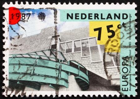 herman: NETHERLANDS - CIRCA 1987: a stamp printed in the Netherlands shows Montessori School designed by Herman Hertzberger, Amsterdam, circa 1987 Stock Photo