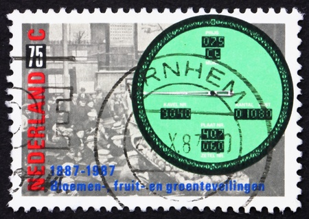 bidding: NETHERLANDS - CIRCA 1987: a stamp printed in the Netherlands shows Auction, Bidding and Price Indicator 1987, Centenary of Sale of Produce by Auction, circa 1987 Stock Photo