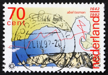NETHERLANDS - CIRCA 1992: a stamp printed in the Netherlands shows Discovery of New Zealand and Tasmania by Abel Tasman, 350th Anniversary, circa 1992 Stock Photo - 12179772